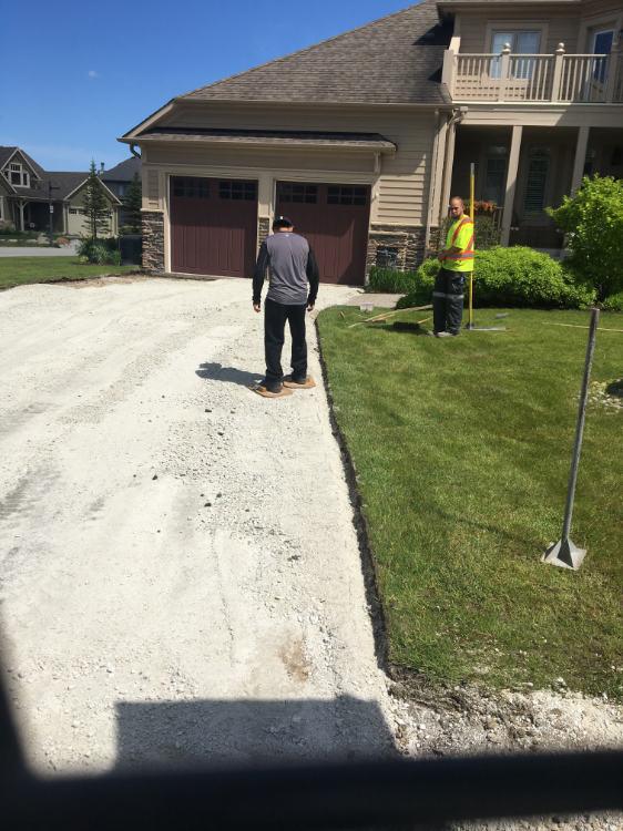 prepping a residential driveway for asphalt