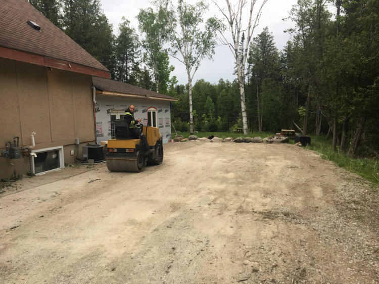prepping driveway with gravel before paving with asphalt