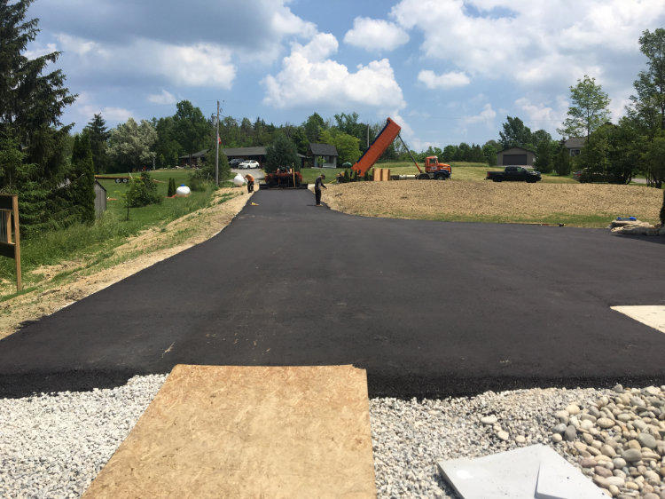 Asphalt driveway freshly paved at a residential property