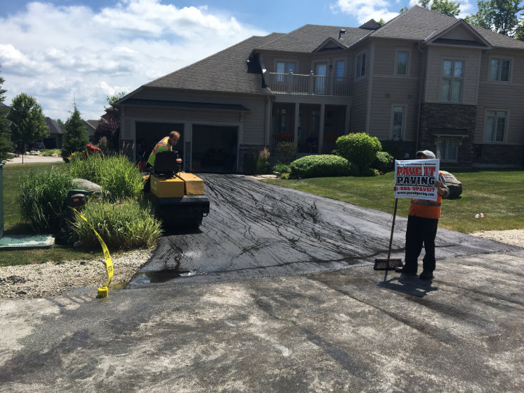smoothing out the asphalt at a residential job site