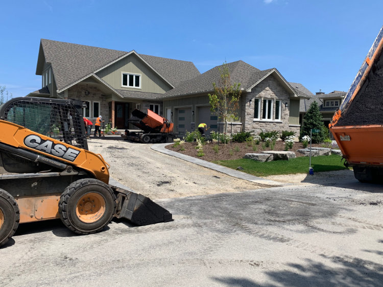 starting to lay asphalt at a residential job site