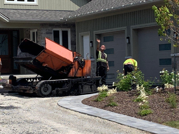 getting ready to start laying asphalt on a prepped residential driveway