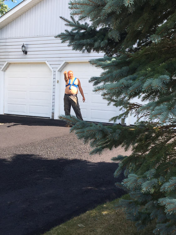 getting ready to smooth out the other half of a residential driveway