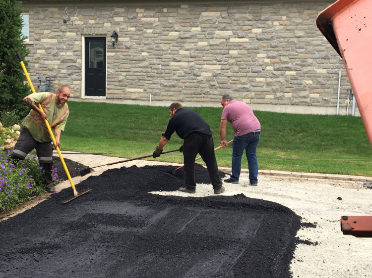 spreading out the asphalt on a residential property