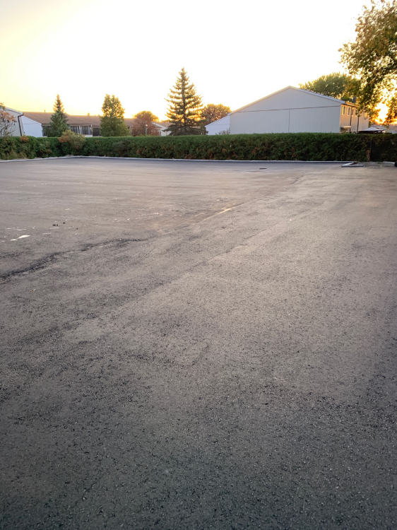 freshly paved commercial parking lot