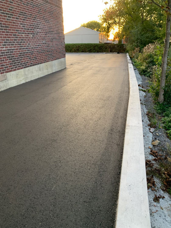 freshly paved commercial laneway
