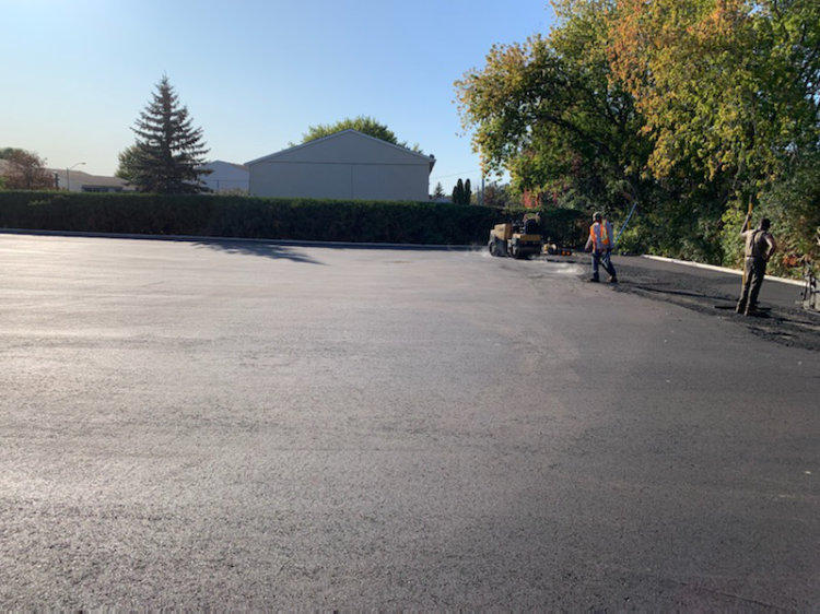just finishing up a freshly paved commercial parking lot