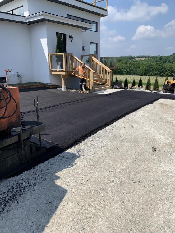 compacting an asphalt driveway