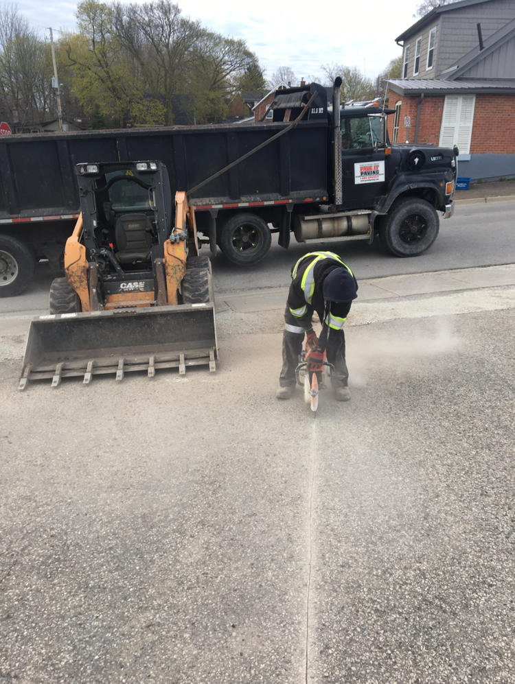 cutting up old driveway for new asphalt