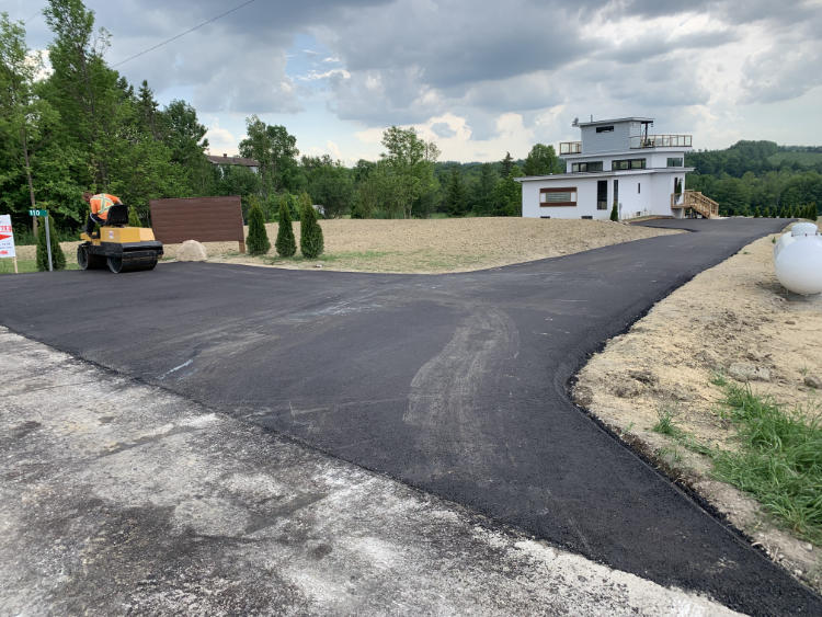 finishing up a new asphalt driveway